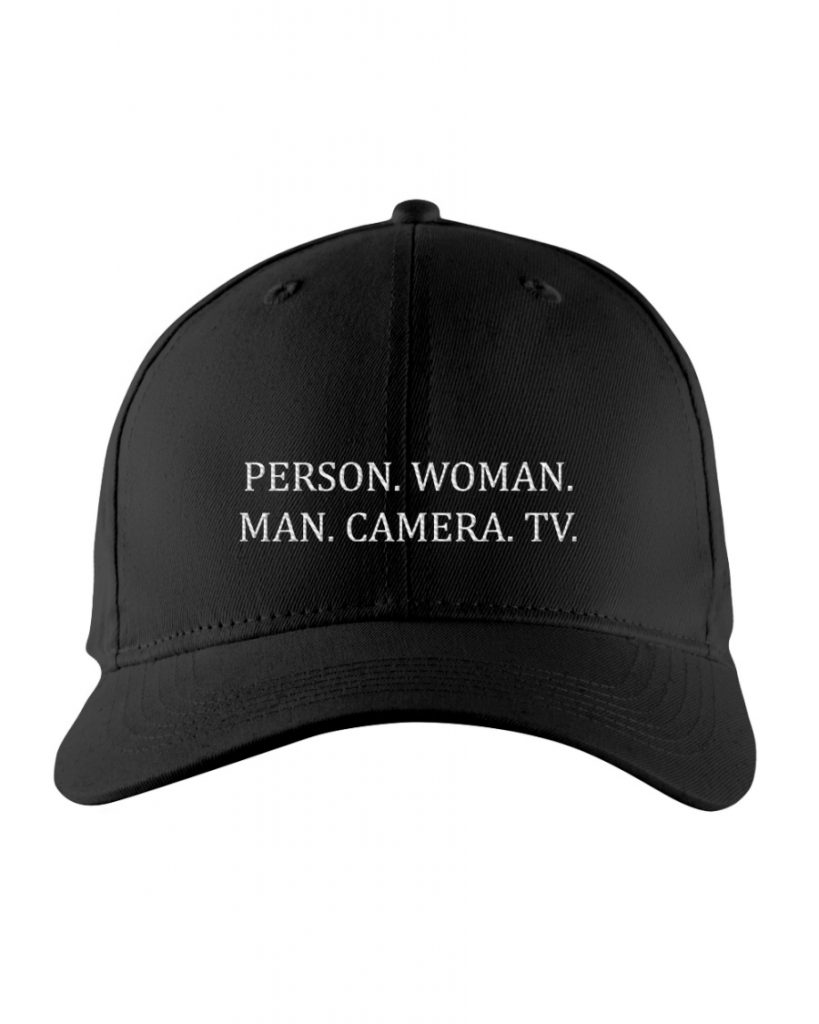 person woman man camera tv hat